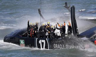 The crew on Oracle Team USA celebrates after winning the 19th race against Emirates Team New Zealand to win the America's Cup sailing event on Wednesday in San Francisco.