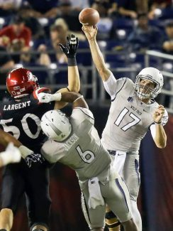 Nevada quarterback Cody Fajardo fires a pass over San Diego State linebacker Derek Largent during the second quarter of an NCAA college football game on Friday, Oct. 4, in San Diego.