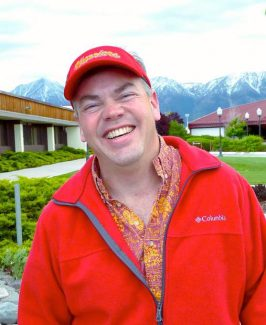 Lake Tahoe resident Kevin Kjer wears Warrior red at Douglas High School on Wednesday evening. He is cautiously optimistic that Whittell High School parents can work with the Douglas County School District to protect the school.