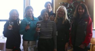 Some of the women who participated in last weekend's performance ski camps at Sierra-at-Tahoe enjoying a glass of wine after a day of skiing with coordinator Lauren O'Reilly center.