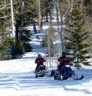 Snowmobilers drive through the snow near Spooner Summit in January 2013.