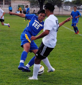 South Tahoe's Ben Hannah Khoa Tran shakes off Fallon's Austin Bischoff during Thursday's match in Fallon. South Tahoe won, 2-1.