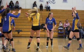 The South Tahoe volleyball team celebrates its win over Spring Creek at South Tahoe High School Saturday.