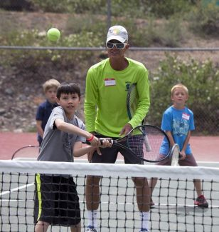 Rob Wheatley watches Jordan Berry hit a volley at the Annual Kids Clinic hosted by the Zephyr Cove Tennis Club.