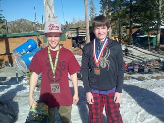 Heavenly Ski Education Foundation athletes Gunnar Barnwell and Tyler Oliviera with their medals.