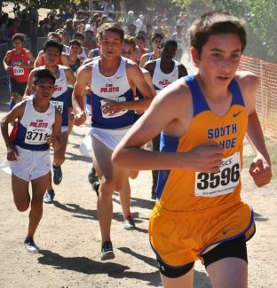 South Tahoe junior David Holmes charges up the hill in front of a pack of runners during the Asics Clovis Invitational on Saturday, Oct. 8, at Woodward Park in Fresno, California.