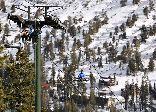 Skiers make their way up the slope on a chairlift last Saturday during opening day at Kirkwood.