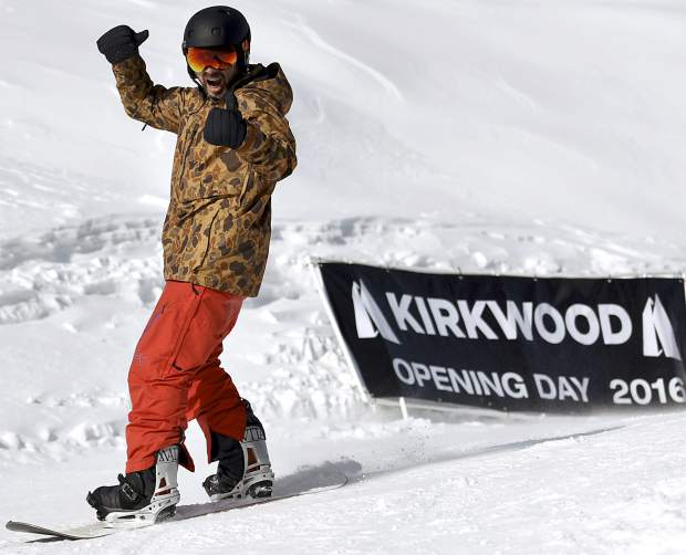 The stoke level is high for this snowboarder making a run during opening day at Kirkwood Mountain Resort on Saturday, Nov. 26.