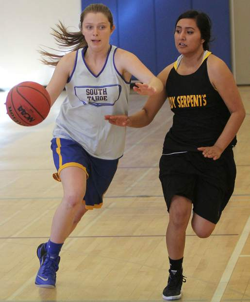 South Tahoe senior Brooke Erdody dribbles against a Mineral County defender during a scrimmage at the Gold Gym on Saturday, Nov. 19.