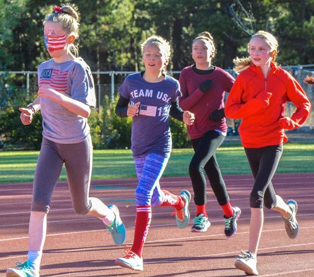 Timberwolves sixth graders make the turn during a running event Oct. 7.