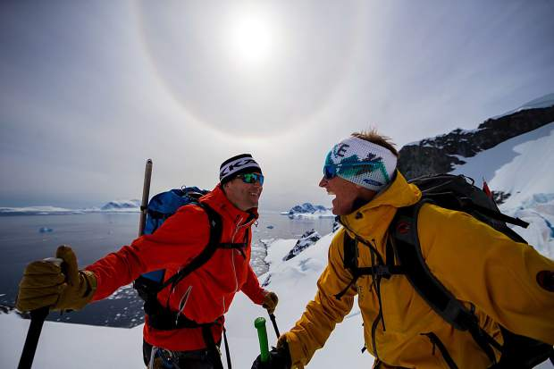 Chris Davenport and Todd Offenbacher celebrate a first descent in Antarctica.