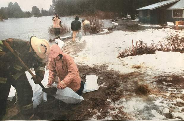 Lake Valley Fire Department personnel and residents who live along Sawmill Road try to stem the flow of the Upper Truckee River near U.S. 50 on Wednesday, Jan. 1, 1997.
