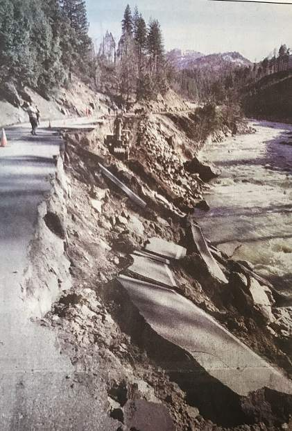 Road repair crews work on a 100-foot section of U.S. 50 that collapsed into teh Amreican River during the flood in early January 1997.