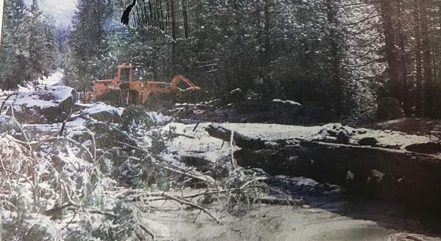 California Department of Transportation road crews near Strawberry work on clearing U.S. 50 of mud, rocks and trees in early January 1997.