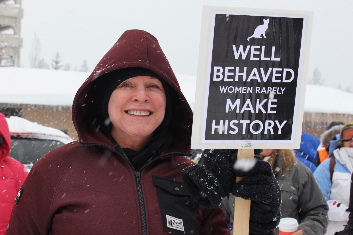 A women poses with her sign prior to the march.