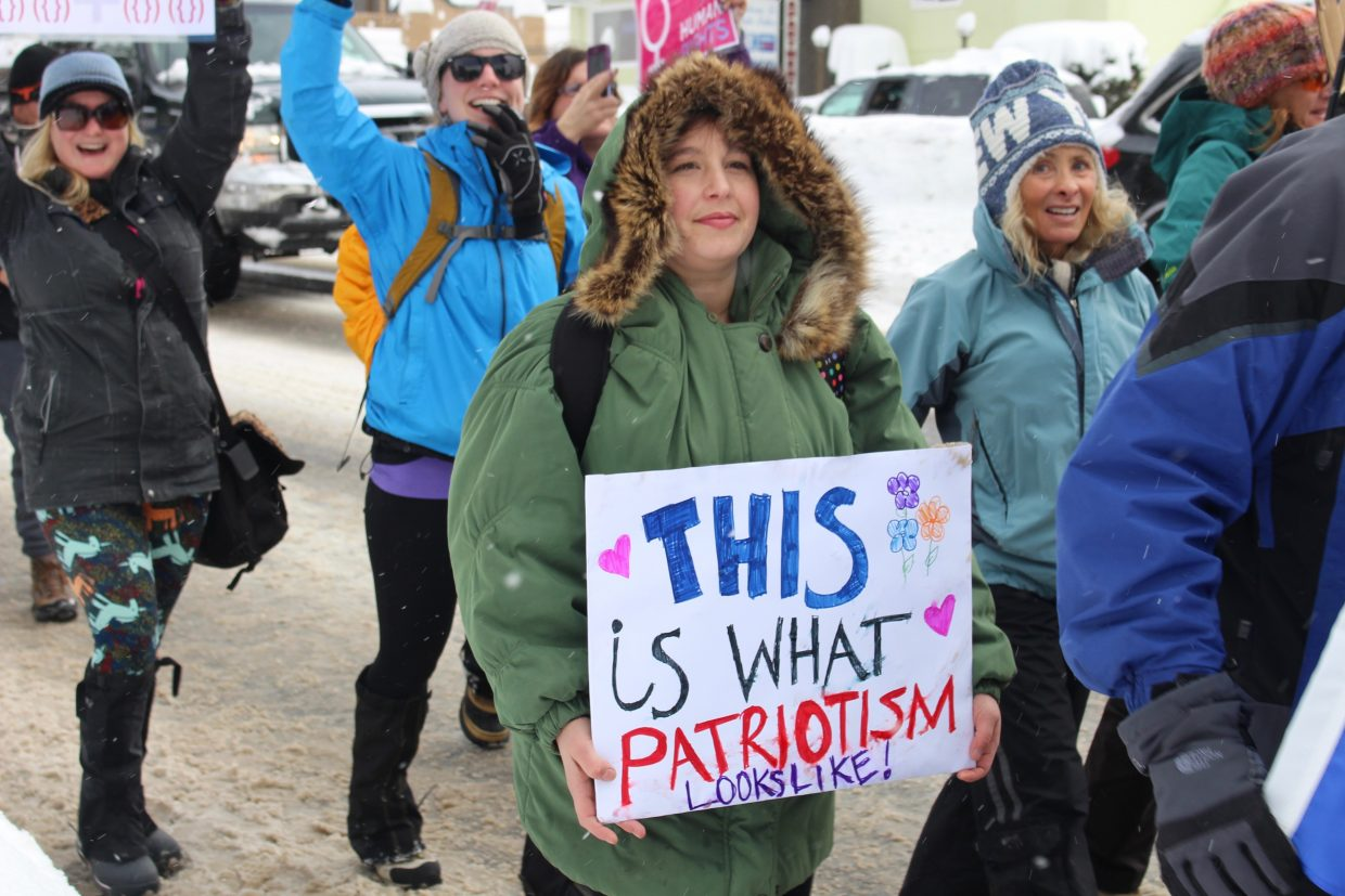 Marchers cheered as they walked down snowy Highway 50.