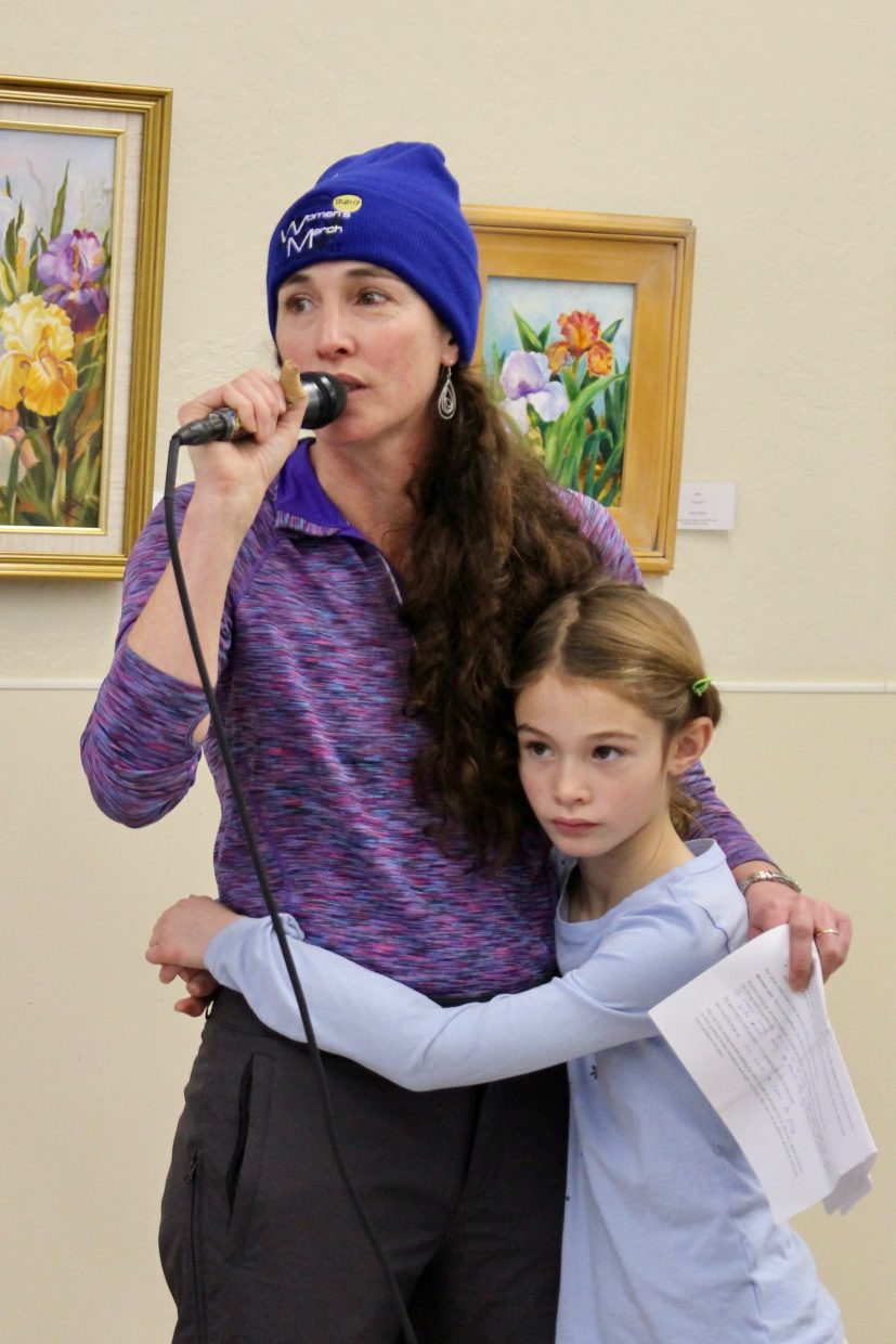 Annie Davidson, pictured with her daughter, delivered a speech on the importance of getting involved.