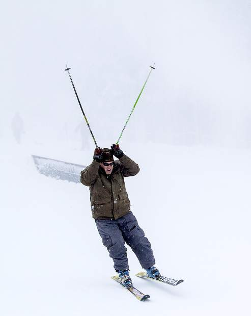 A skier celebrates opening day at Mt. Rose Ski Tahoe Wednesday, Nov. 4. For more photos from recent storms, turn to page 15.