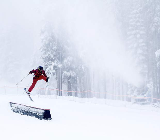 A skier jumps for joy last year at the opening of Mt. Rose Ski Tahoe in November 2015.