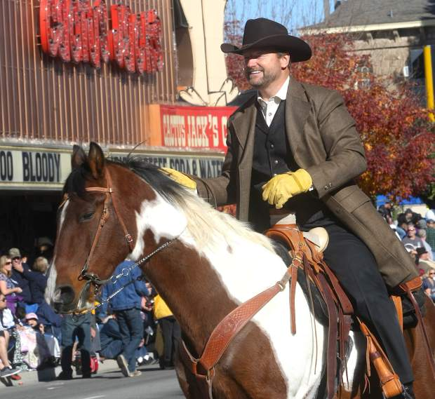 Sen. Dean Heller rides his horse in the parade.