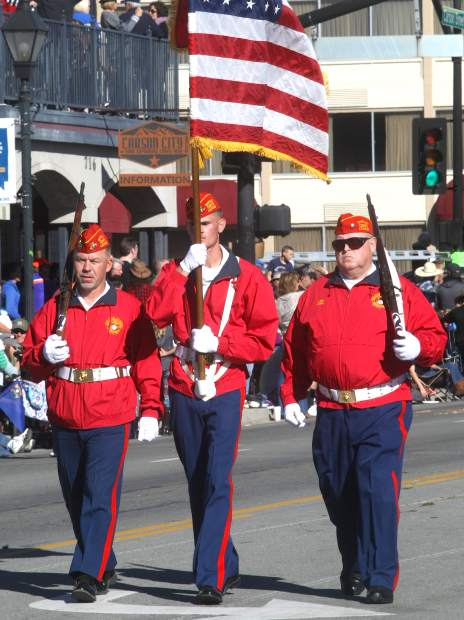 The Marine League Color Guard marches in the parade.