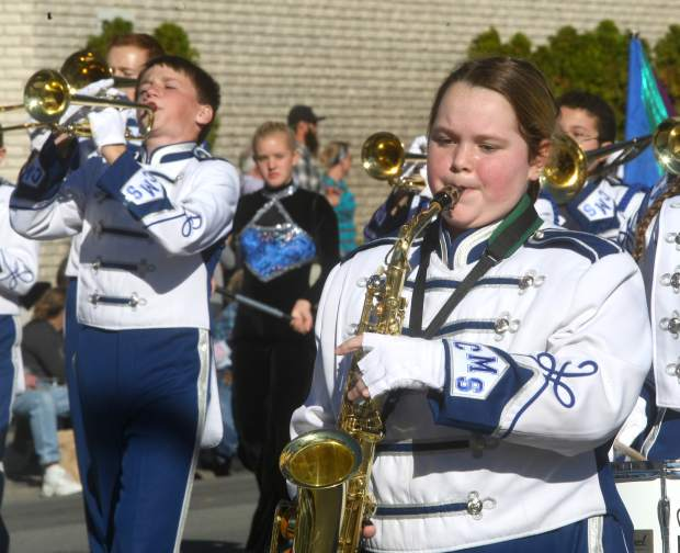 Members of the Carson Middle School marching band perform on Saturday.