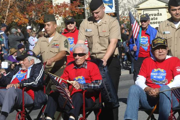 Honor Flight Nevada Veterans and Guardians take part in the parade.