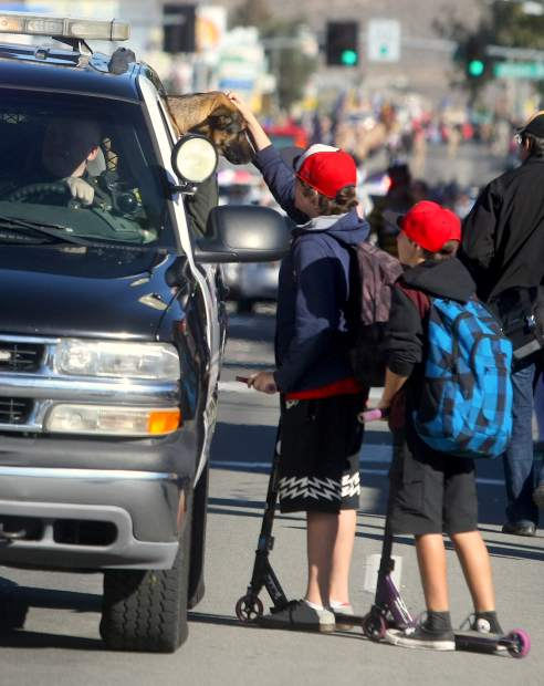 Two young boys pet a Carson City K-9 during a brief stop of the parade.