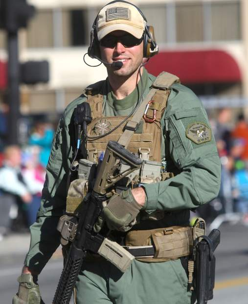 A Carson City SWAT member walks in the parade.