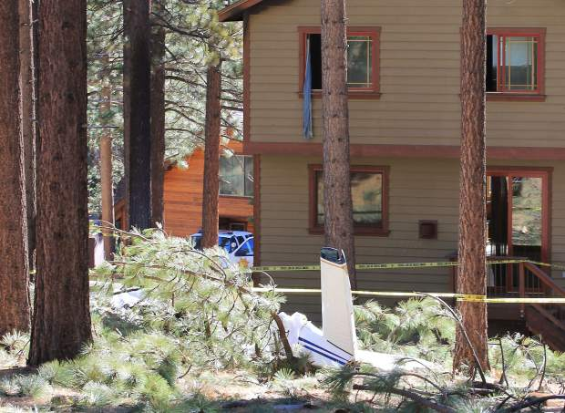 A portion of the single-engine aircraft's tail sits beside the South Lake Tahoe residence that caught fire after the crash. The pilot of the plane and a passenger died in the crash. Their identities have yet to be released. The crash is currently under investigation by the FAA and NTSB.