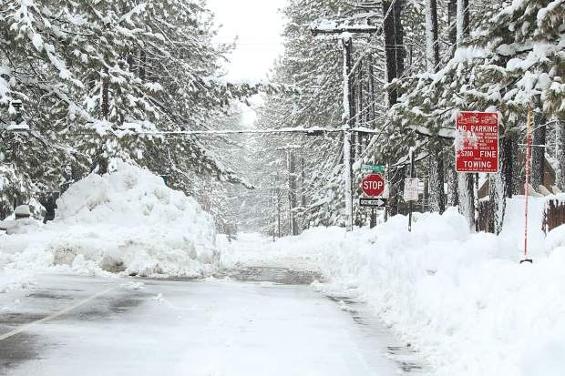 Snow coats a side street in South Lake Tahoe. City crews continue to work in 12-hour shifts with primary snow removal, the city said Thursday.