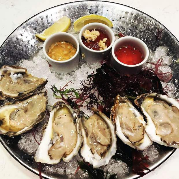 A must-try at Oyster Bar: Seasonal oysters with Black Pepper and Granny Smith Apple Mignonette.