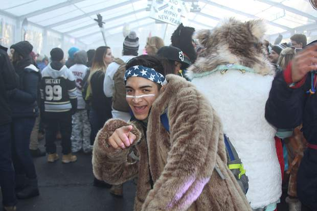 A fan dances inside The Igloo at SnowGlobe Day 2.