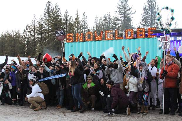 A group of festivalgoers pose at the start of SnowGlobe Day 2.