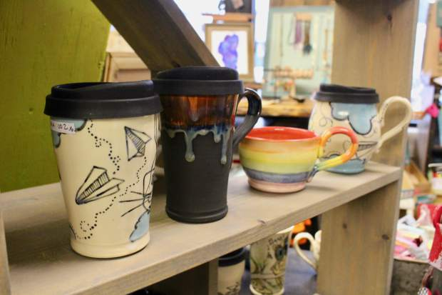 Mollie Mason hand crafts and paints ceramic pottery at her studio on the South Shore.