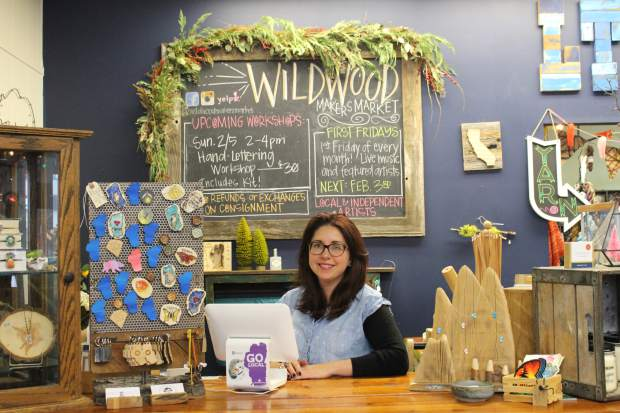 Wildwood Makers Market owner Lisa Utzig Schafer stocks her store with goods made by local artists.