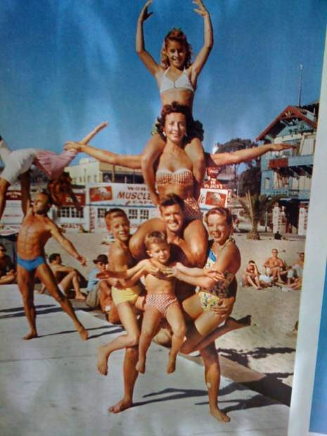 The Ferges family performs their signature pyramid stunt with Carol on top at Muscle Beach in Santa Monica.