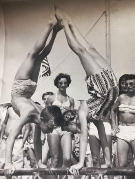 A young Carol and Darryl Ferges perform a synchronized handstand.
