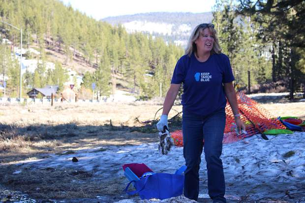 A League to Save Lake Tahoe volunteer reacts to a dirty diaper that was found at the popular sledding destination.