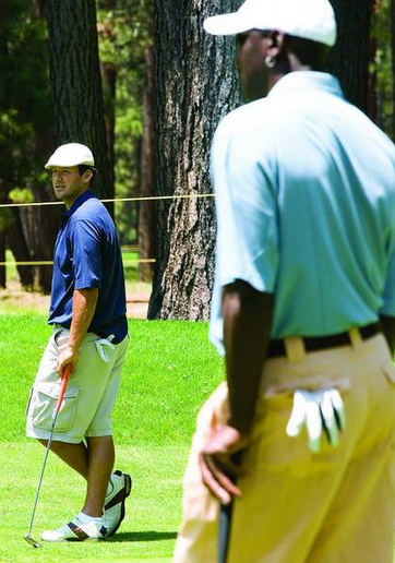 Tony Romo, left, and former NBA player Michael Jordan pause on the green at Edgewood Tahoe Golf Course during a practice round in 2008.