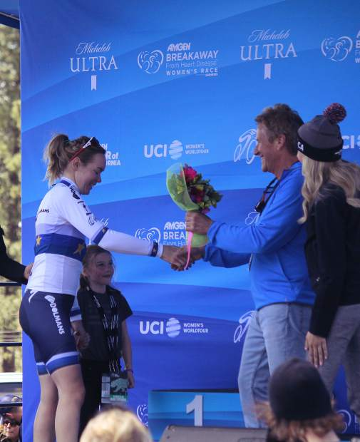 South Lake Tahoe Mayor Austin Sass presents Boels-Dolmans team member Anna Van Der Breggen with an honorary bouquet of flowers for finishing second in the Amgen race.