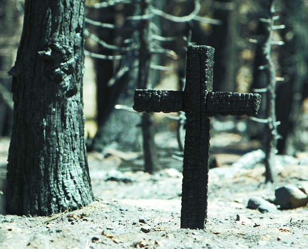 Jim Grant/Tahoe Daily Tribune A charred marker stands in the pet cemetary that was hit by the Angora fire.