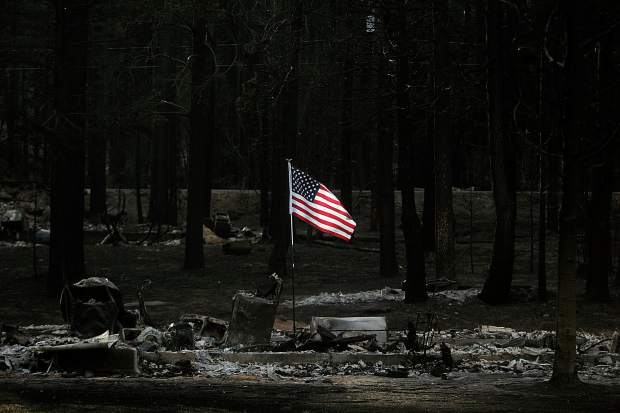 <b>Published Caption: </b>An U.S. flag is illuminated at sunset Saturday, June 30, 2007, on the site of a home on Lake Tahoe Boulevard that was destroyed by the Angora Fire in South Lake Tahoe, Calif. (AP Photo/Nevada Appeal, Brad Horn) <br><b>Photographer's Caption: </b>An U.S. flag is illuminated at sunset Saturday, June 30, 2007, on the site of a home on Lake Tahoe Boulevard that was destroyed by the Angora Fire in South Lake Tahoe, Calif. (AP Photo/Nevada Appeal, Brad Horn)