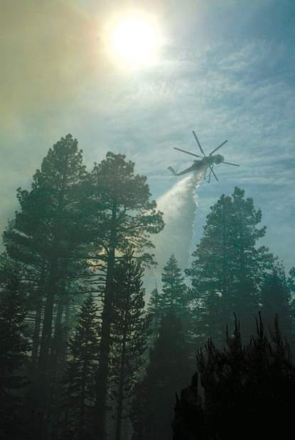 Dan Thrift/Tahoe Daily Tribune A drop is made as the Angora Fire flared up Tuesday afternoon threatening to cross Emerald Bay Road near 15th Street.