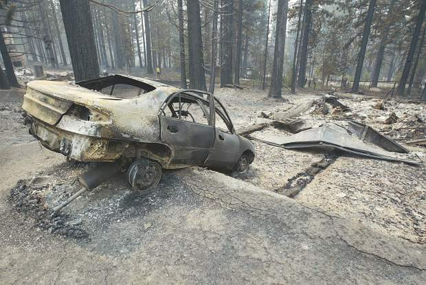 <b>Published Caption: </b>None <br><b>Photographer's Caption: </b><b>Published Caption: </b>Bonanza News Service - Dan Thrift A car is in ruin in the Tahoe Mountain area after being devastated by the Angora Fire. <br><b>Photographer's Caption: </b>None