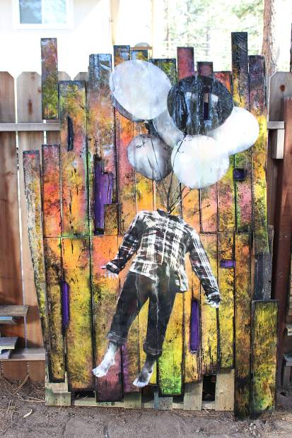 Eichelberger creates custom backdrops to paint using reclaimed wood from fences and pallets.
