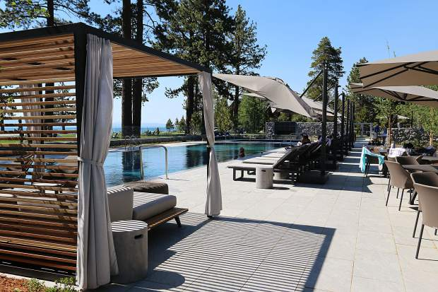 Guests lounge by the pool overlooking the lake at The Lodge at Edgewood Tahoe.