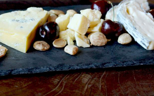 The cheese plate combines a pirate blue (a mild blue cheese) with a bright meadow cheddar, rocket's robiola, marcona almonds and Bing cherries.