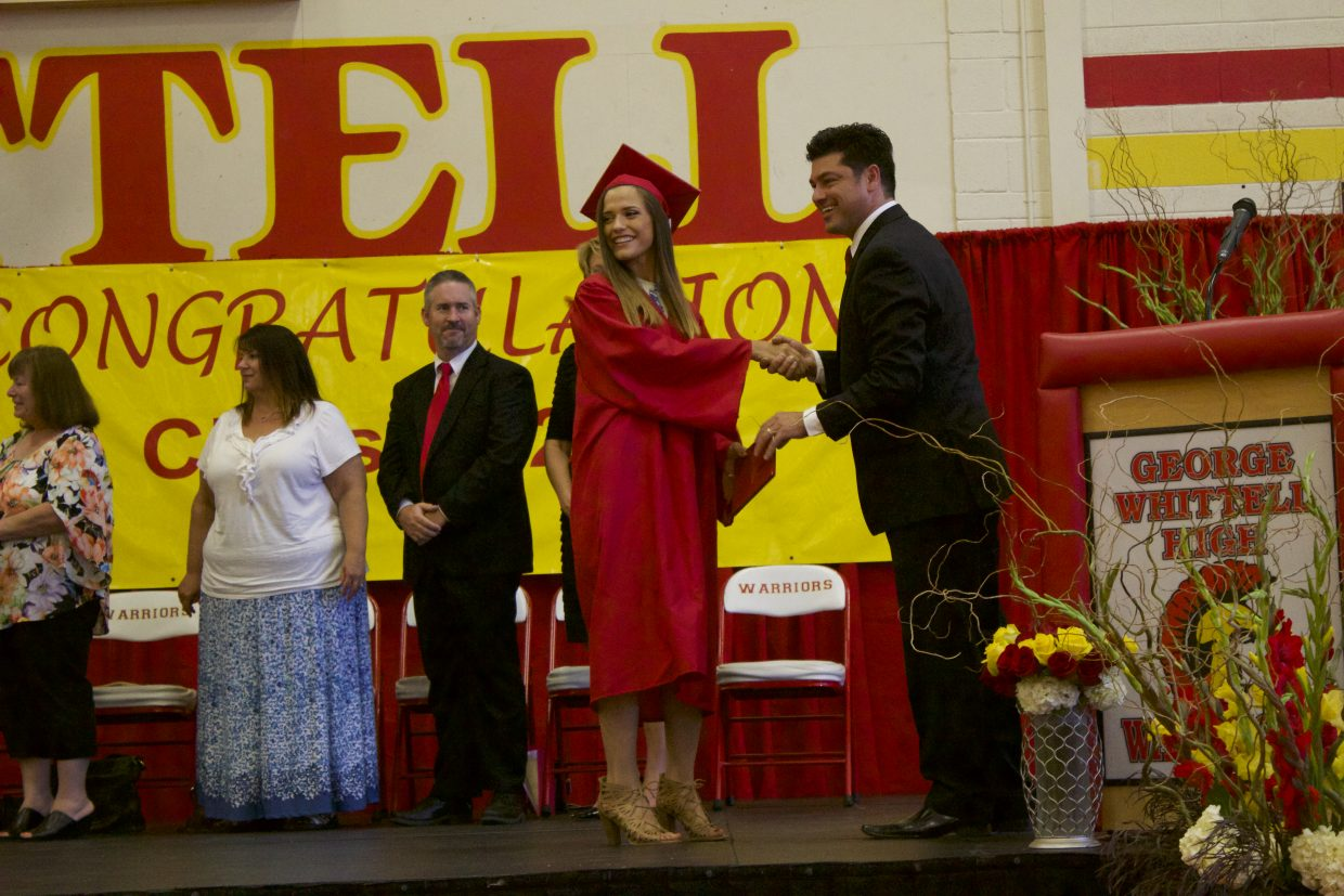 Michele Barnes is all smiles as she accepts her diploma from GWHS principal Crespin Esquivel.