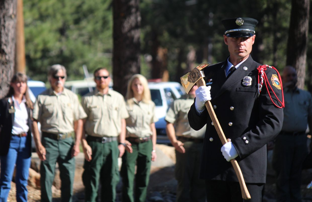 Mike Anderson, a firefighter/paramedic with the Lake Valley Fire Protection District, stands at attention Saturday, June 24.